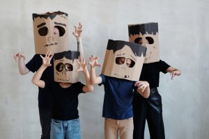 A mom, dad, son, and daughter with Frankenstein heads made from cardboard boxes